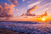 Sunrise over the Atlantic Ocean with the surf washing up on the shore; Indialantic, Florida, United States of America