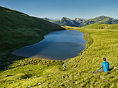 a wanderer, Lake Friesenhals, Nockberge National Park, Carinthia, Austria The