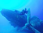 Scuba diver swimming near underwater airplane wreck, Akdeniz, Mersin Province, Turkey