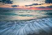 Long exposure of Gulf of Mexico coast at scenic sunset, Florida, USA