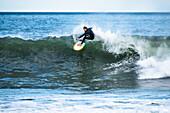 Man surfing hurricane surf from Hurricane Irma, Point Judith, Narragansett, Rhode Island, USA