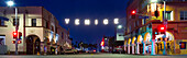 Panorama of famous Venice Beach sign lit up at night, Los Angeles, California, USA