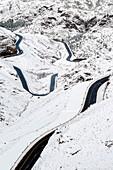 Winding road through Tizi N'Tichka pass in the Atlas Mountains in winter, Marrakesh-Safi, Morocco