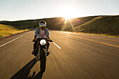 Front view of man riding motorcycle on road, Emigration Canyon, Utah, USA