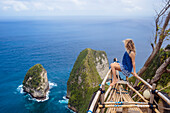 Adult woman admiring coastline of Nusa Penida island, Bali, Indonesia