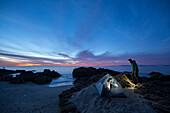 Couple tent camping along the shoreline of the Sea of Cortez in Baja California del Sur, Mexico.