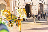 Typical exhibition of traditional clothes and flags of the different contradas Piazza del Campo Siena Tuscany Italy Europe