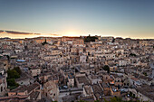 View of the ancient town and historical center called Sassi perched on rocks on top of hill, Matera, Basilicata, Italy, Europe