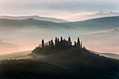 red sunrise in the hills, san Quirico d'orcia, val d'orcia, siena, tuscany, italy