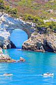 Two boats pass in front of San Felice Arch(Architiello di San Felice), Apulia(Puglia), Italy
