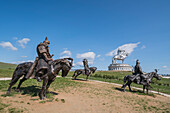 Statues of the Mongolian Empire warriors and Genghis Khan Statue Complex in the background, Erdene, Tov province, Mongolia