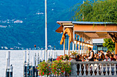 Bellagio, lake Como, Como district, Lombardy, Italy, Tourists eating out