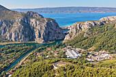 Cetina river canyon between the mountains, in the background Omis ant the adriatic sea, Dalmatia, Adriatic Coast, Croatia