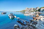 Small boats moored on the waterfront of Omis, Dalmatia, Adriatic Coast, Croatia