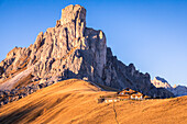 lonely chalet at the feet of La Gusela of the Averau, Dolomites, Giau pass, Colle Santa Lucia, Belluno, Veneto, Italy