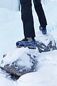 detail of a winter footwear with mounted trekking crampons, Agordino, Dolomites, Belluno, Veneto, Italy