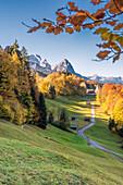 Wamberg, Garmisch-Partenkirchen, Bavaria, Germany, The little Wamberg village with the Mount Zugspitze and the Mount Waxenstein