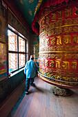 Stupa of Boudhnath,Katmandu,Nepal Buddhist circling around a prayer wheel