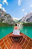 Lake Braies,Braies,Bolzano province,Trentino Alto Adige,Italy Girl admires the Braies Lake by boat