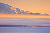 Panoramic of sunrise on the snowy landscape, Bjorkliden, Abisko, Kiruna Municipality, Norrbotten County, Lapland, Sweden