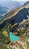 Panoramic of turquoise Lago Lagazzuolo from drone, Chiesa In Valmalenco, Province of Sondrio, Valtellina, Lombardy, Italy