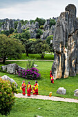 Sani minority girls with traditional dress at Stone Forest or Shilin, Kunming, Yunnan Province, China, Asia, Asian, East Asia, Far East