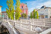 The old town of Ljubljana, with the Ljubljanica river, the Triple Bridge and the iconic Franciscan Annunciation church, Ljubljiana, Osrednjeslovenska, Slovenia