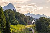 The iconic Wamberg Church, with Mount Waxenstein on the background, Wamberg, Garmisch Partenkirchen, Bayern, Germany