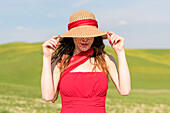San Quirico d'Orcia, Orcia valley, Siena, Tuscany, Italy, A young woman with straw hat