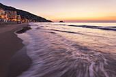 Dawn on Alassio beach and Gallinara Island, Alassio, Savona province, Liguria, Italy