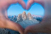 hands forming an heart framing the Tre Cime di Lavaredo, Sexten Dolomites, South Tyrol, Bolzano, Italy