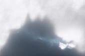 Foggy sky above Cime Del Largo, Bregaglia Valley, canton of Graubunden, Switzerland