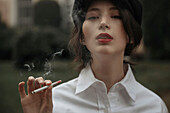 Caucasian woman smoking cigarette