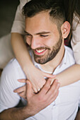 Caucasian woman hugging smiling man