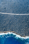 Aerial view of ocean waves on beach, Big Island, Hawaii, United States