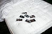 Photographs on bed mattress