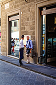 Street scene between two waiters, Florence, Italy, Toscany, Europe