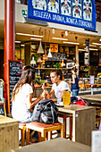 Tourists enjoying local food at Mercato Centrale, Via dell'Ariento, Florence, Italy, Toscany, Europe