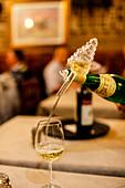 fancy way of pouring wine in the glass, Ristorante Etruria, Piazza dei Priori, Volterra, Italy Tuscany, Europe