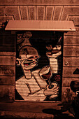 Graffiti on the door of la raffineria, restaurant in Livorno, Italy, Europe