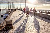 Tourists on the Pier in Viareggio at the Sunset, Viareggio, Tuscany, Italy, Europe