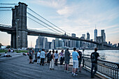plenty of photographers with tripods taking photos of the Brooklyn Bridge and the skyline of Manhattan, Brooklyn, NYC, New York City, United States of America, USA, North America