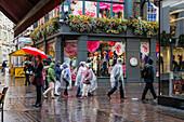 People with Umbrellas on Carnaby Street, Soho,  London