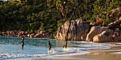 Granite boulders on the shore at Anse Lazio, Baie Sainte Anne district, Island of Praslin, Seychelles, Indian Ocean, Africa