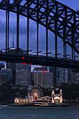 Sydney Harbour Bridge with Luna Park amusement park on North shore, Sydney, New South Wales, Australia, Pacific