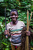 Baka pygmy man hunting in the jungle in the Dzanga-Sangha Special Reserve, UNESCO World Heritage Site, Central African Republic, Africa