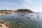 Boats moored in the harbor, Porto Azzurro, Elba Island, Livorno Province, Tuscany, Italy, Europe