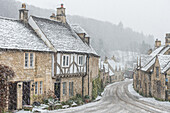 Looking down the quintessential English village of Castle Combe in the snow, Wiltshire, England, United Kingdom, Europe