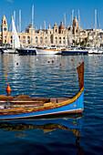 Traditional boat moored in Grand Harbour marina at Birgu, Valletta, Malta, Mediterranean, Europe
