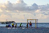 Children playing on the beach Soccer, Ostseeküste, Mecklenburg-Western Pomerania, Germany